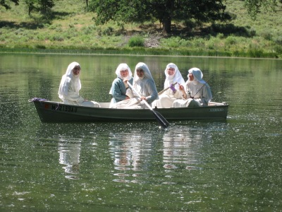 Novice canonesses rowing on the lake.