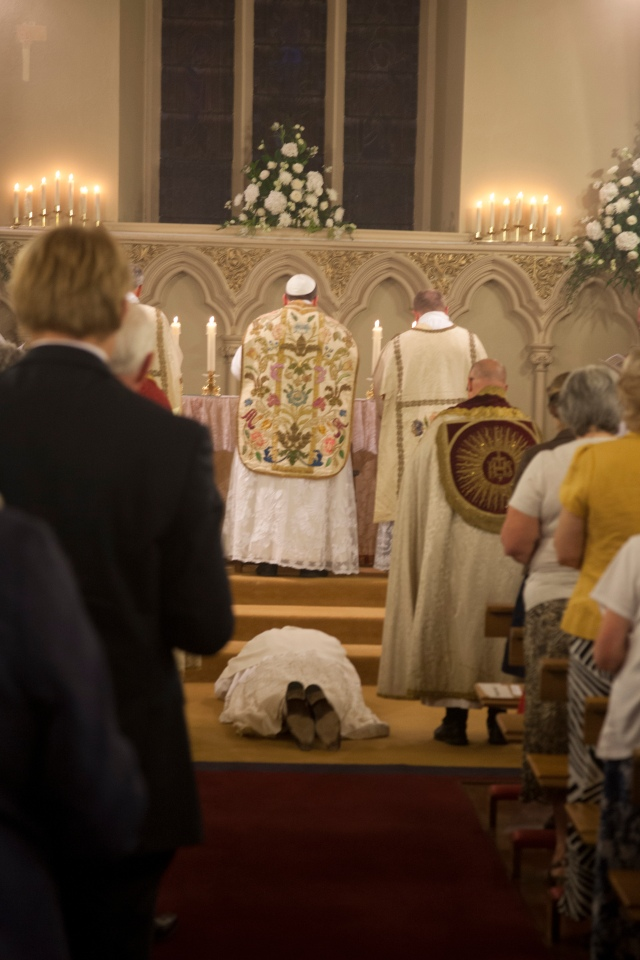 Br Stephen lies prostrate before the altar as the Litany of the Saints is sung.